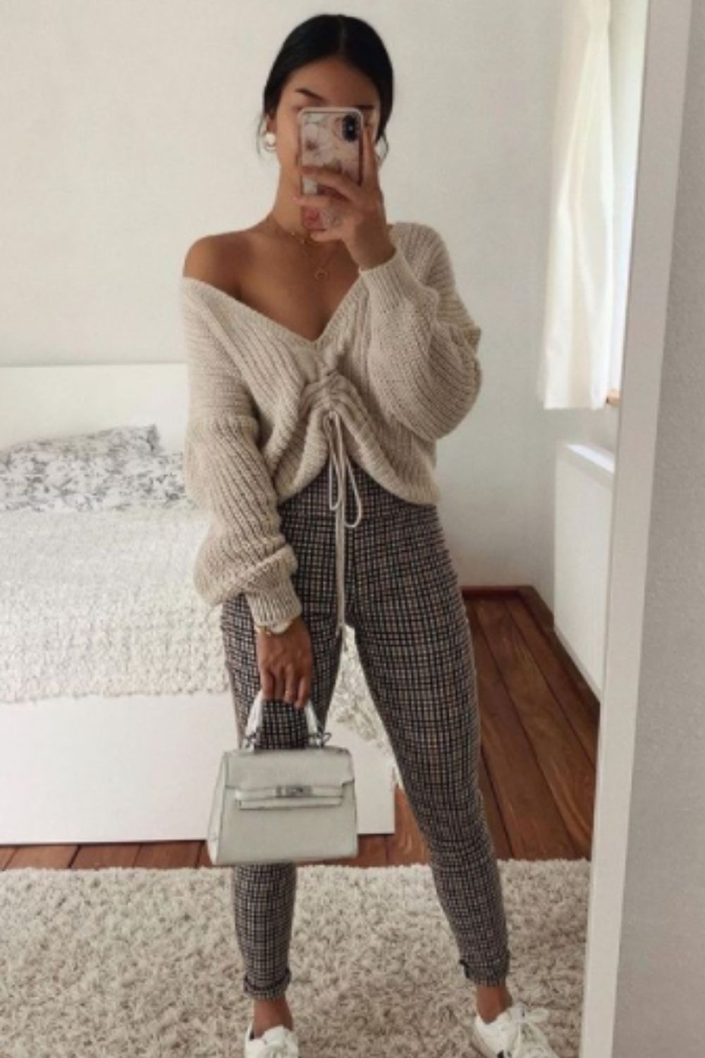 Stylish fall outfit with a sweater
